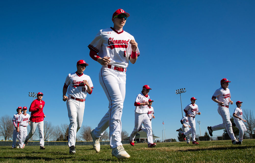 Glenwood's Lucas Ryan and the Titans warm up before facing U-High at Chatham Community Park's Bob Erickson Field Monday, March 26, 2019. Major League Baseball begins Thursday when 30 teams will play, marking the earliest opening day in history. [Ted Schurter/The State Journal-Register]