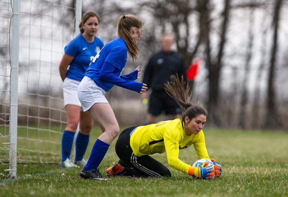 Auburn goal keeper Krystal Bly (25) makes a stop in front of the net against Williamsville at Auburn Jr. High School, Thursday, March 28, 2019, in Divernon, Ill. [Justin L. Fowler/The State Journal-Register]