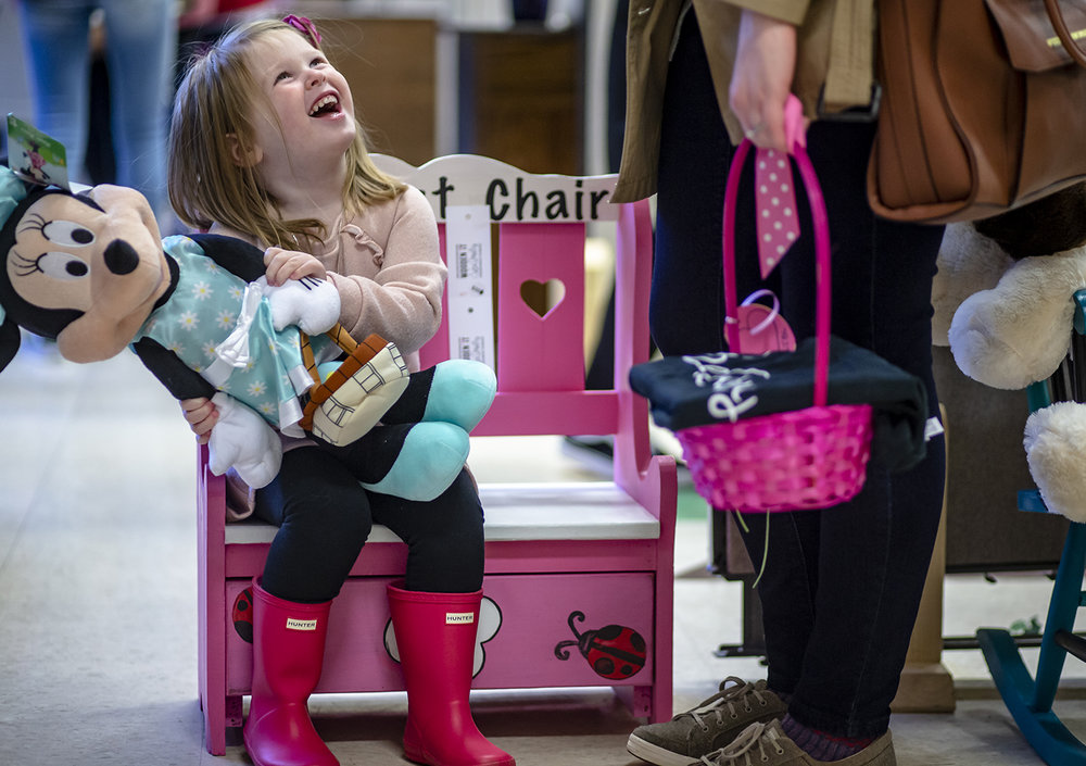 Penelope Leitner, 3, tries out one of the refurbished children's benches for sale during the Wooden It Be Lovely  Showcase Spring Sale at Douglas Avenue United Methodist Church, Saturday, March 30, 2019, in Springfield, Ill. The Wooden It Be Lovely Showcase Sale features refurbished furniture created by women, known as associates, who are struggling with addiction or other serious issues and are offered transitional employment and support through refurbishing furniture. [Justin L. Fowler/The State Journal-Register]