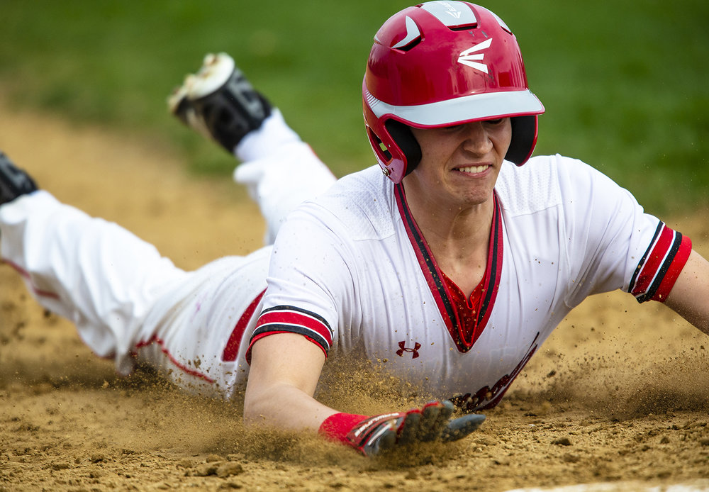 Glenwood's Jake Jurgens (12) slides safely into third base after advancing off a Jacksonville error in the first inning at Chatham Community Park, Wednesday, April 3, 2019, in Chatham, Ill. [Justin L. Fowler/The State Journal-Register]