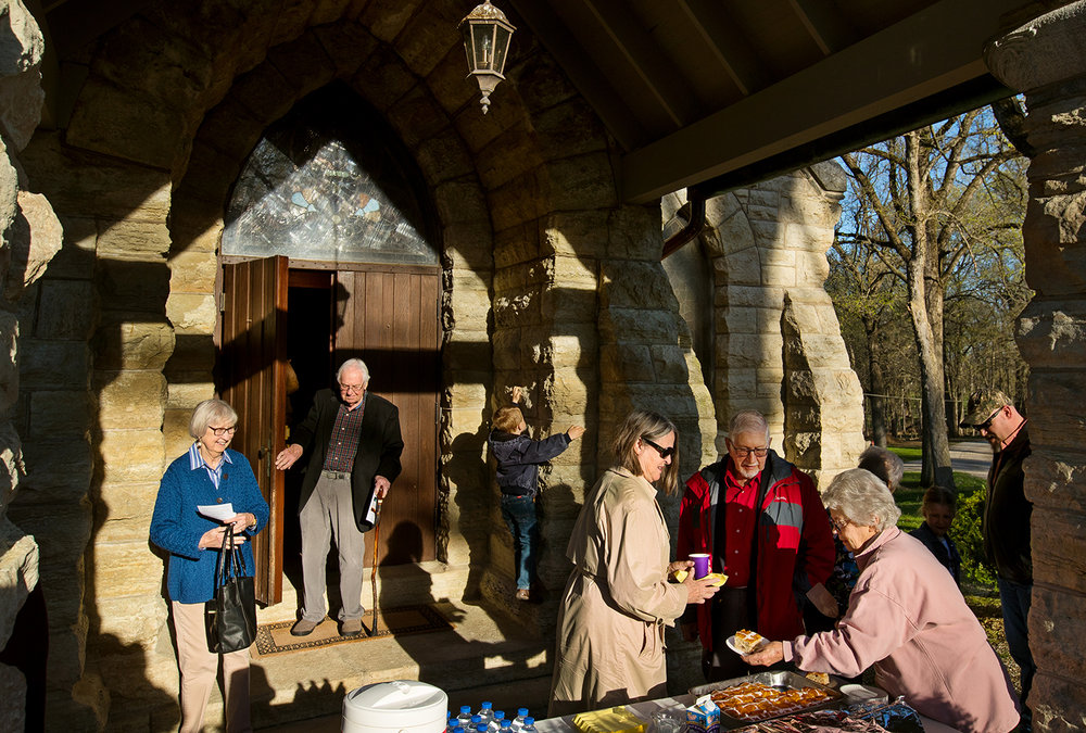 Gillette Ransom serves hot cross buns to guests after a sunrise Easter service at St. John the Baptist Chapel Sunday, April 21, 2019. The  Episcopalian chapel was built in 1890 in Elkhart Cemetery, home to the grave of former U.S. Senator and three-term Illinois governor Richard Oglesby. [Ted Schurter/The State Journal-Register]