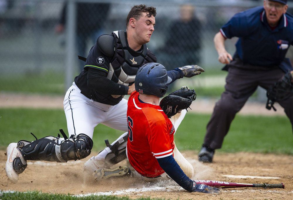 Rochester's PJ Jerszynski (6) beats the throw to slide safely into home plate against Normal U-High catcher Paul Africano (20) in the 4th inning to tie the game 1-1 at Rochester High School, Tuesday, April 23, 2019, in Rochester, Ill. [Justin L. Fowler/The State Journal-Register]