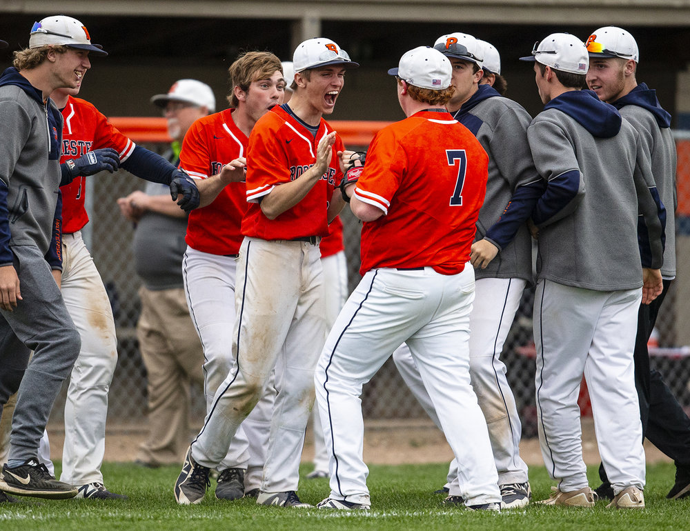 Rochester's Bryce Thompson (10) celebrates with Drew Lenz (7) as he comes off the mound after the Rockets defeated Normal U-High 2-1 at Rochester High School, Tuesday, April 23, 2019, in Rochester, Ill. [Justin L. Fowler/The State Journal-Register]