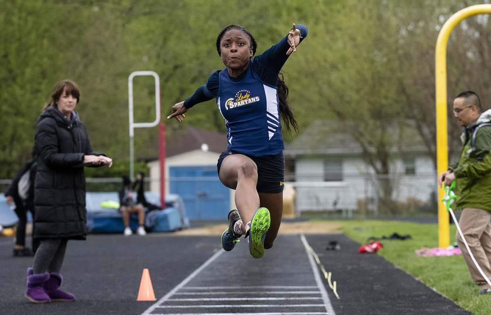 Southeast High School's Serena Bolden jumps for 37-10 in the triple jump at the Girls City Track Meet Wednesday, April 24, 2019 at Southeast High School in Springfield, Ill. [Rich Saal/The State Journal-Register]
