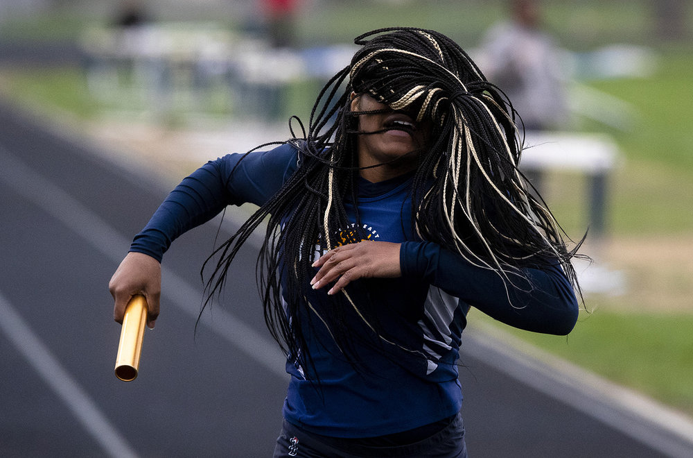 Southeast High School's Shawntiana Howze, who anchored the final leg of the 4x100-meter relay, slows after crossing the finish line first during the Girls City Track Meet Wednesday, April 24, 2019 at Southeast High School in Springfield, Ill. [Rich Saal/The State Journal-Register]