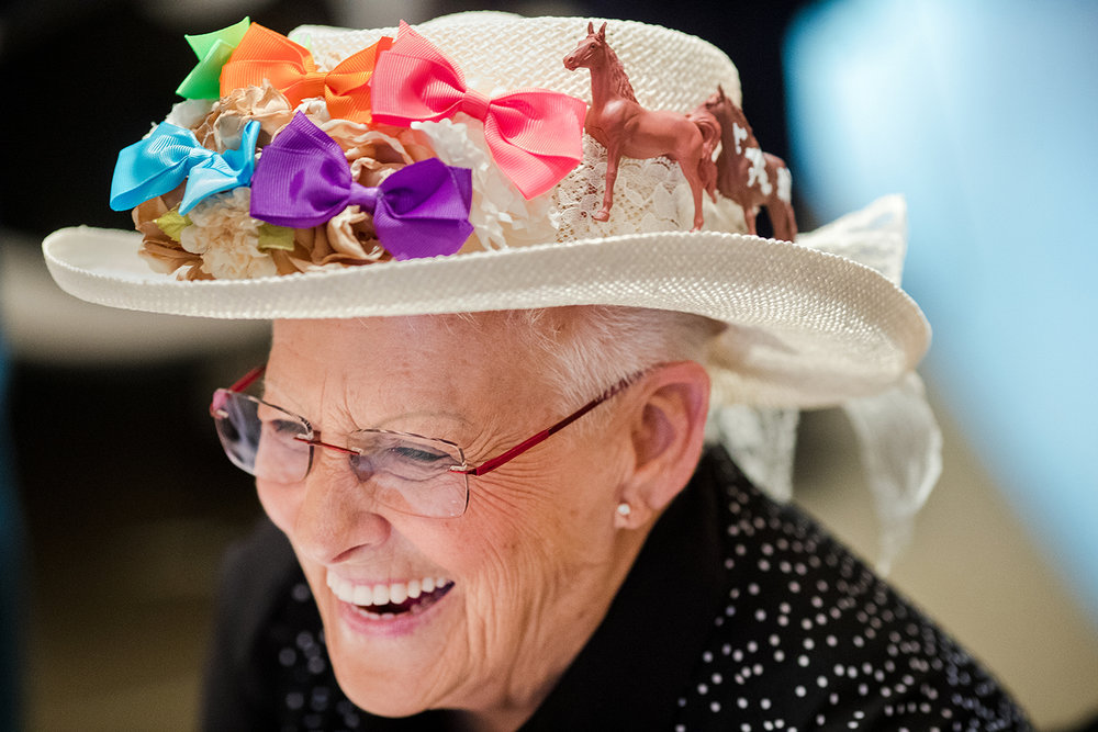 """Linda Rowden decorated her derby hat with toy horses for the Educational Center for the Visually Impaired's 2nd annual """"Dining in the Dark"""" fundraiser at Christ the King Parish Center Hall Thursday, April 25, 2019. The lights gradually dimmed during the Kentucky Derby themed to give patrons the experience of fading vision.  [Ted Schurter/The State Journal-Register]"""
