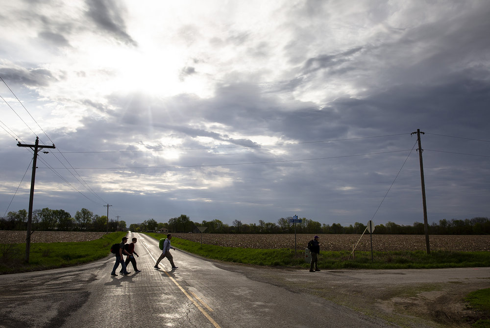 Boy Scouts and their leaders cross Gudgel Road in Menard County on the 94th Lincoln Trail Hike from New Salem State Historic Site to Stuart Park on Springfield's northwest side Saturday, April 27, 2019  in Springfield, Ill. [Rich Saal/The State Journal-Register]