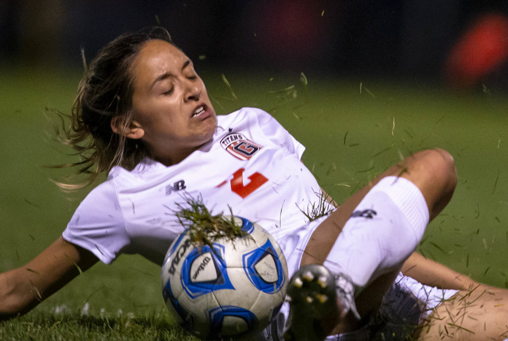 Glenwood's Lauryn Martel (2) slides across the pitch going for a ball against Springfield in the second half at Lee Field, Monday, April 29, 2019, in Springfield, Ill. [Justin L. Fowler/The State Journal-Register]