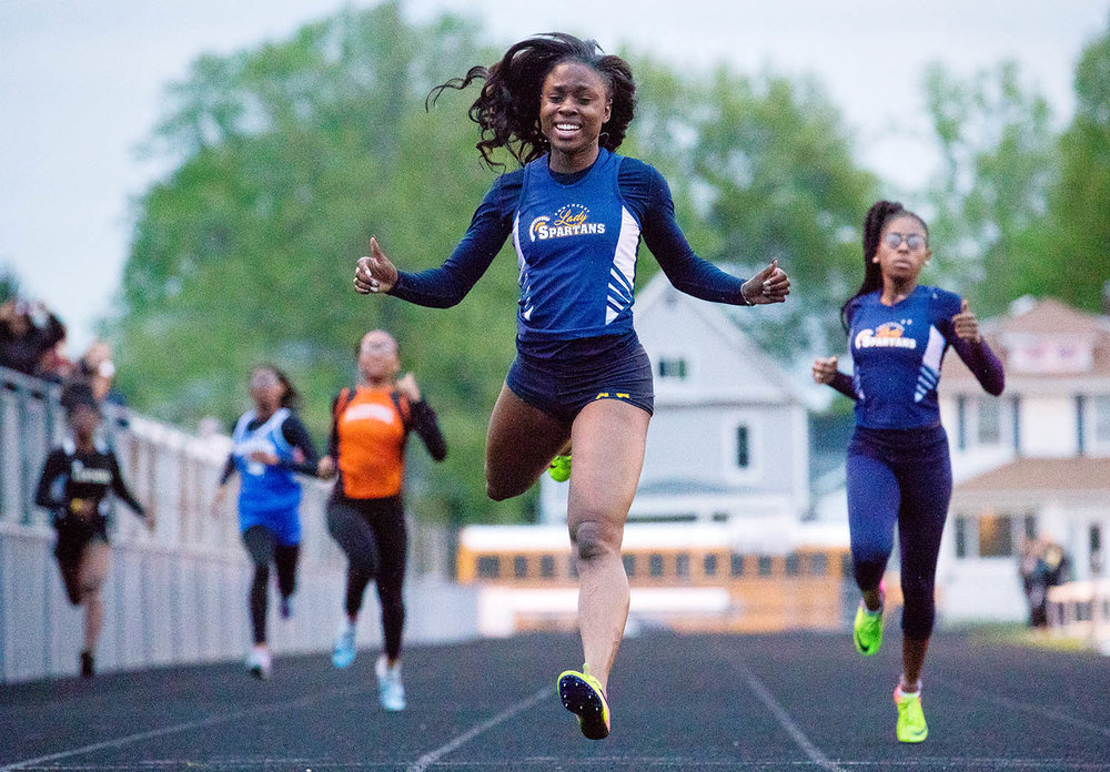 Southeast's Serena Bolden is all smiles as she crosses the finish line in the 200 meter dash during the 2019 Central State Eight Conference Meet at Memorial Stadium Friday, May 3, 2019. [Ted Schurter/The State Journal-Register]