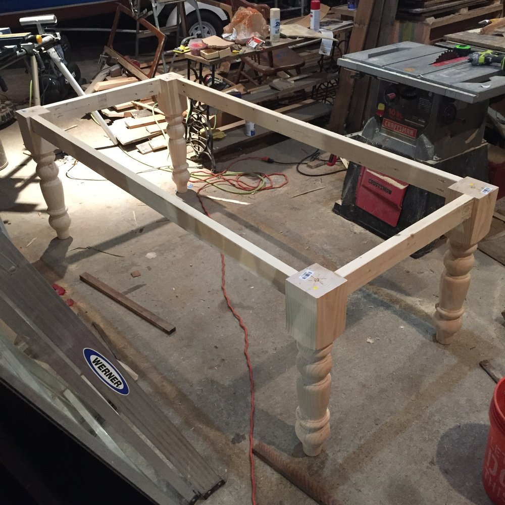 The table frame in a messy wood shop!