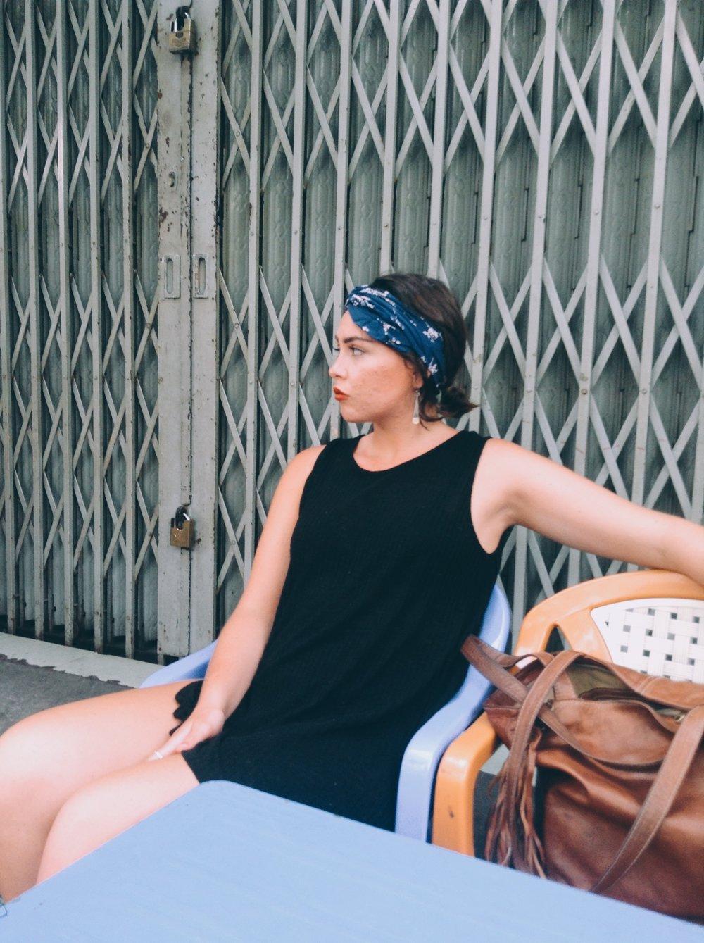 Madison waiting on some Saigon street food
