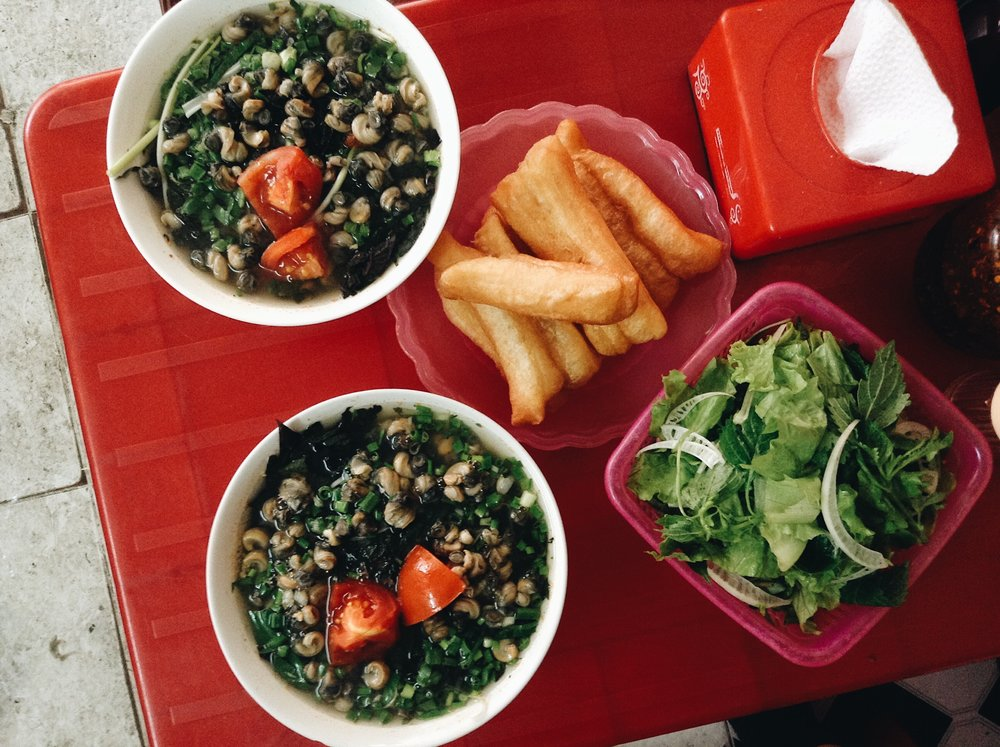 Snail Pho and fried dough in Hanoi, Vietnam