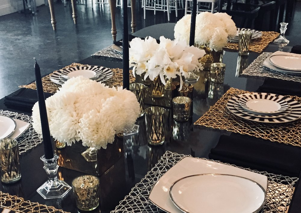 CLAIRE - For the minimalist couple: a clear or gold glass cube is tightly packed with fresh blooms and surrounded by clear or gold glass votives.