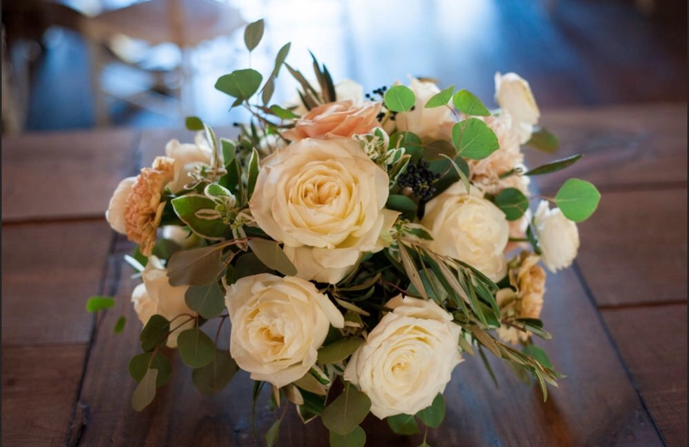 LAUREN  - For all of your vintage barn inspired wedding needs! Our corrugated metal containers will be filled with lush, woodsy blooms - surrounded by clear, clear, or gold votives. Choose from seasonal flowers.