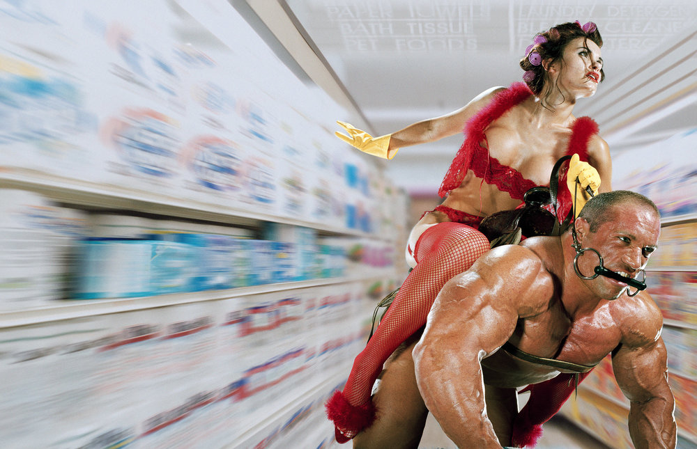 Housewife Riding Bodybuilder in a Supermarket  A concept from Ad-O-Matic, the Koudis online Random Concept Generator  1999, Signed Limited Edition of 20    ORDER OR INQUIRE
