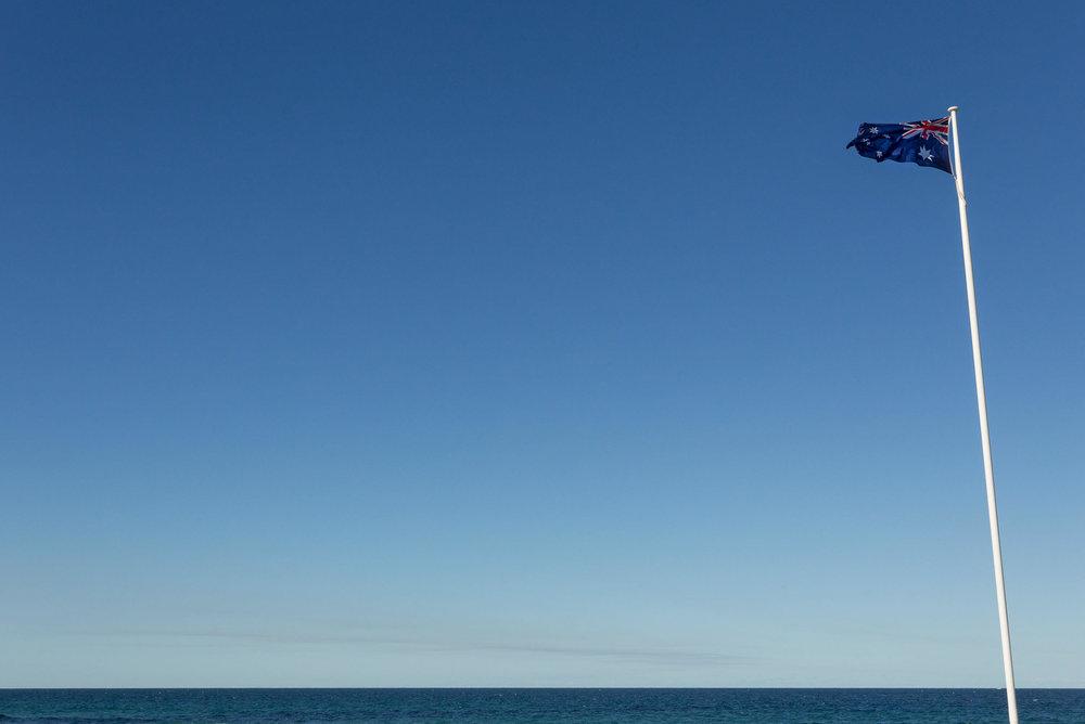 Australian flag waving in the wind.