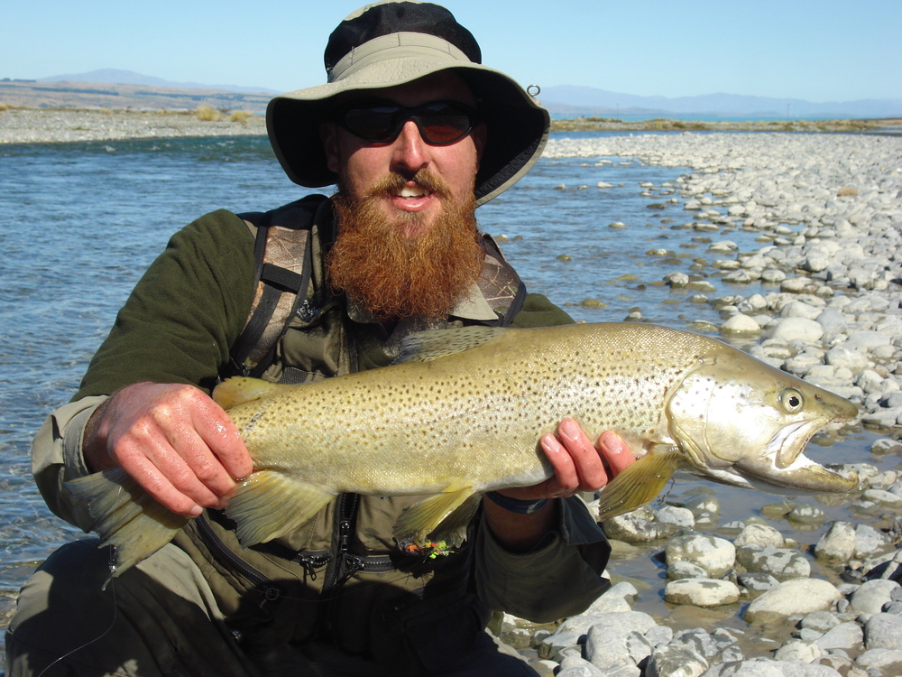 Client holding a trophy brown trout from a Twizel river in the South Island of New zealand