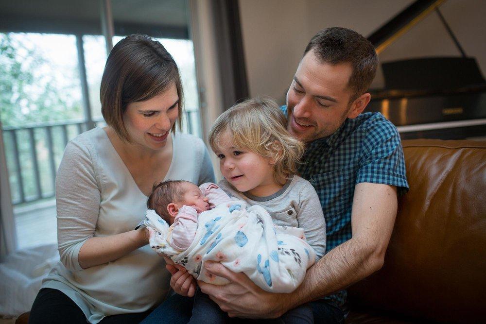 Aston holding baby Helen. Austin lifestyle newborn photographer.