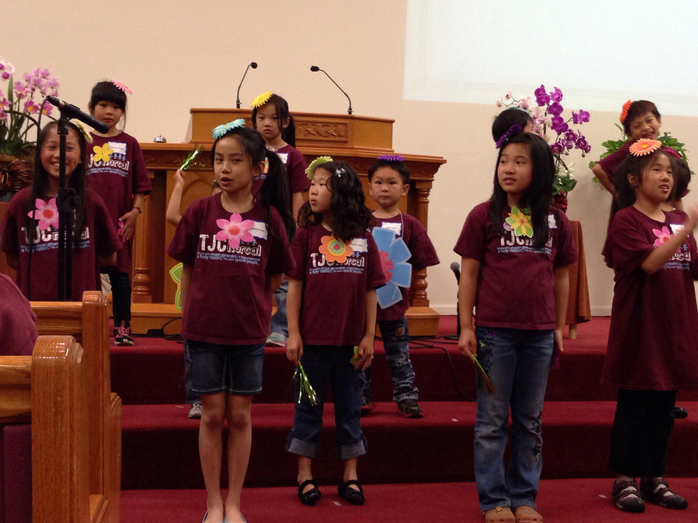 The children perform an adorable song about how the word of God grows in them like a flower sprouting from a seed.