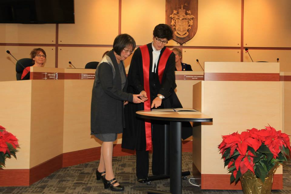 Signing Oath of Office in 2014
