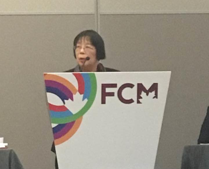 Giving a speech at a Federation of Canadian Municipalities (FCM) conference