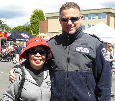 """""""You never know who you might meet at the Esquimalt Family Block Party!    Lynda with Esq Fire Dept – Capt Troy Saladana"""