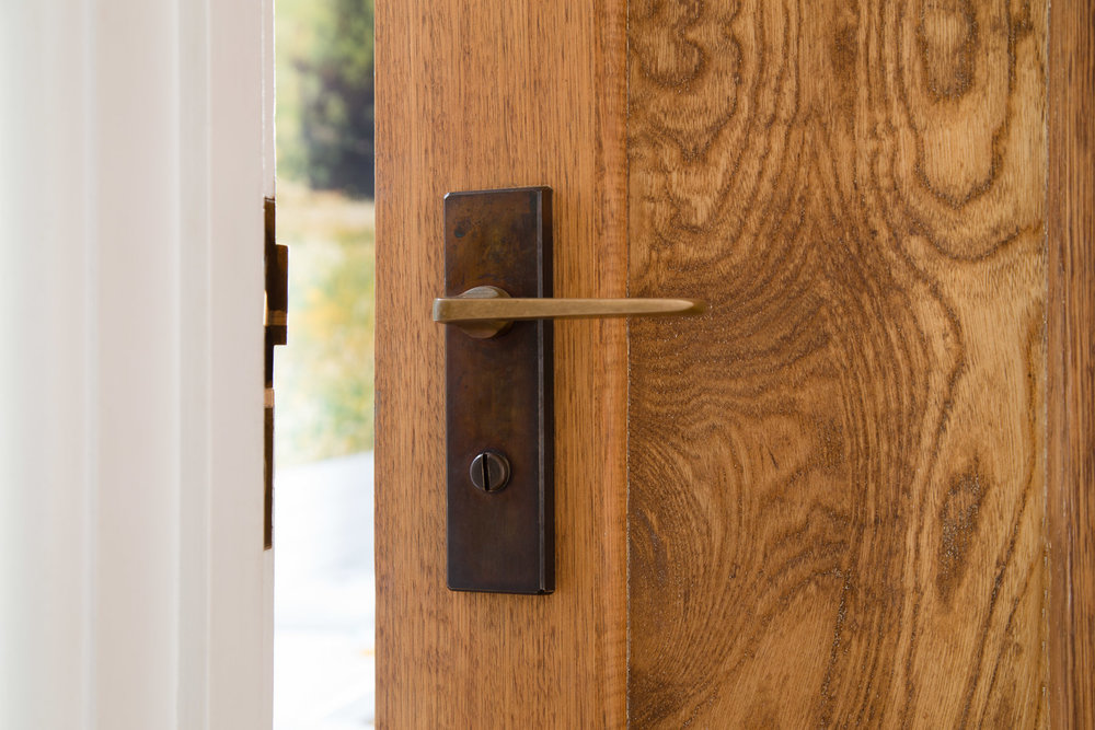 salvaged brass door handles and timber doors were used