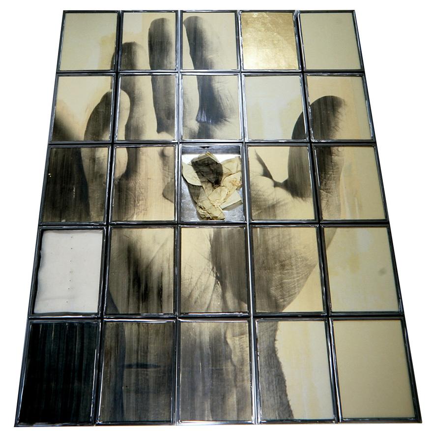 Senza titolo,  1996  Emulsione fotografica su carta, foglia d'oro, tela, ferro e vetro  Polittico, 25 elementi cm. 440 x 340 x 10
