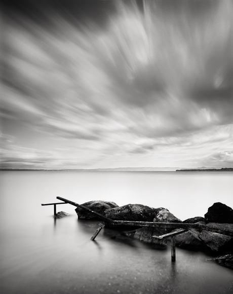 Title: What Remains, Camera: Ebony RSW 45, Lens: Schneider Super Angulon 90 mm, Filter: Lee Big Stopper, Film: Kodak T-Max 100, Exposure: 120″ , f 16, Lac Leman, France, 2012