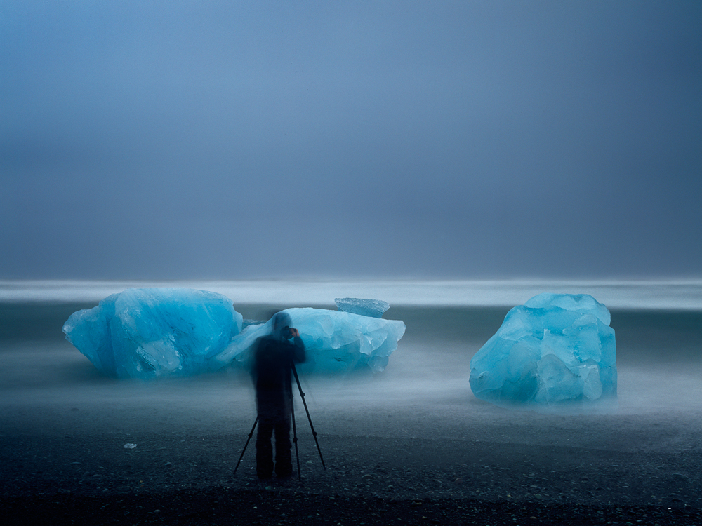 Crowd on Iceland. This gentleman could not care less I was making a long exposure on Velvia. So I used him to add a scale for you to see the size of these beautiful icebergs on the beach near Jokulsarlon.