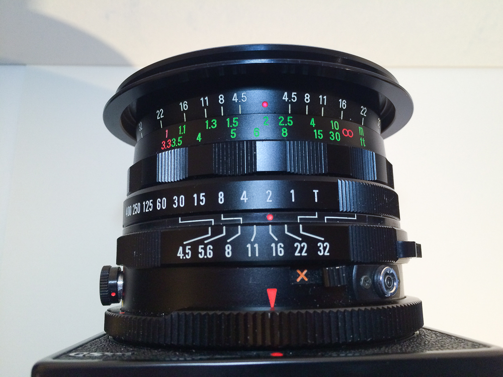 Here is Sekor C 50 set up with f 16 and if focused on 2 meters distance, everything from 1.1 meters to infinity will be in sharp focus. The ring with green numbers is adjusting the floating elements!