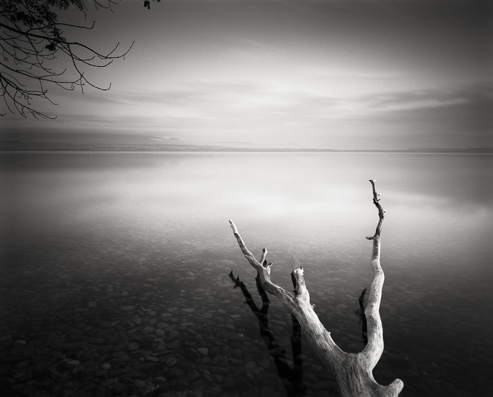 Title: Serenity II, Camera: Ebony SW 45, Lens: Rodenstock Apo-Grandagon 45 mm, Filter: Lee Big Stopper, Film: Kodak T-Max 100, Exposure: 250″ , f 18, Lac Leman, France, 2012