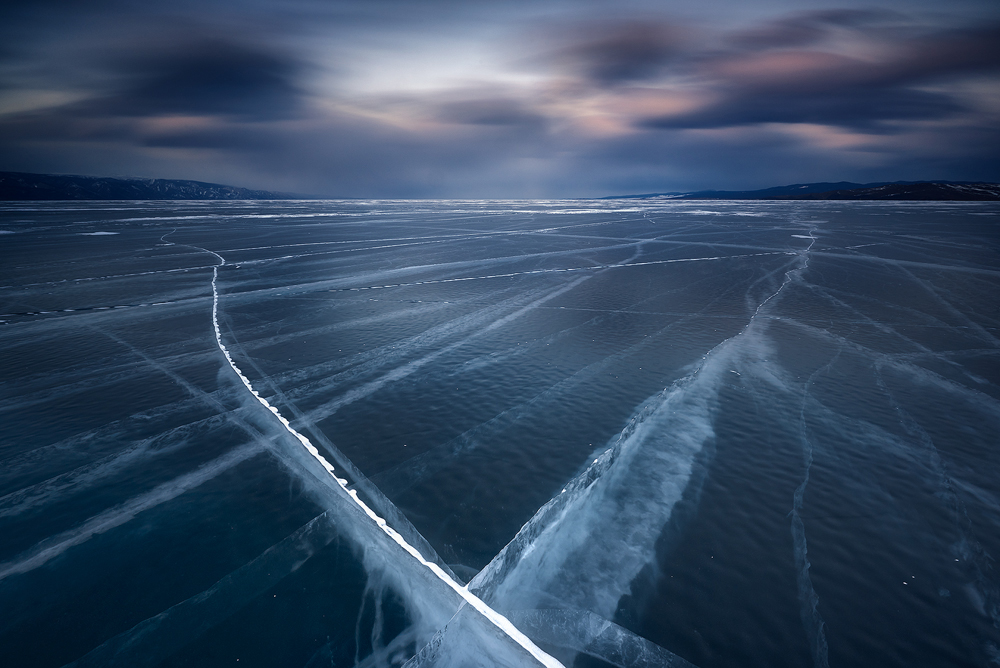 Caption: Walking on Glass, Camera: Nikon D810, Lens: Nikkor 16-35mm, Exposure: 164s, Aperture: f/16, ISO: 64, Filters: Lee Big Stopper & Lee Graduated ND 0.6, Photographed: Baikal Lake, Siberia, Russia, March 2016