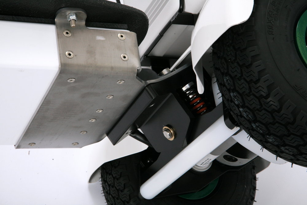 Undercarriage protection system shields axle and component tray from curbs, boulders, roots and other debris