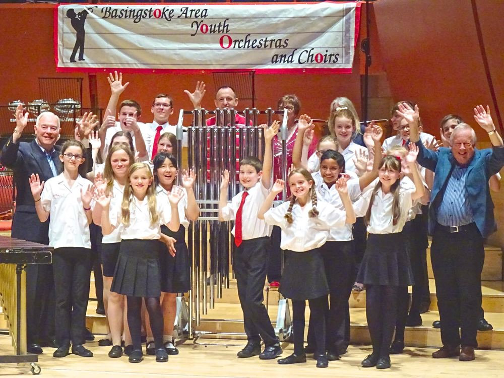 BAYPE celebrate the purchase of tubular bells, enabled by fundraising efforts of the charity, donations from anonymous parent donors (hiding behind the instrument in this image) and local county councillor grants. 2 of the councillors (seen either side of BAYPE) attended the debut concert of the instrument at The Anvil on 9th May 2015.