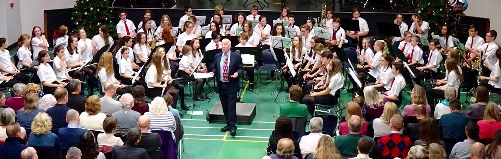 Wind Orchestra Being introduced by John Fuller.