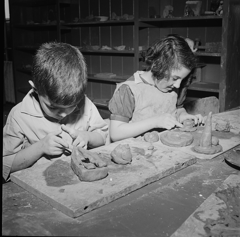 Young ceramic artists shaping mud at Greenwich House Pottery, circa 1944.