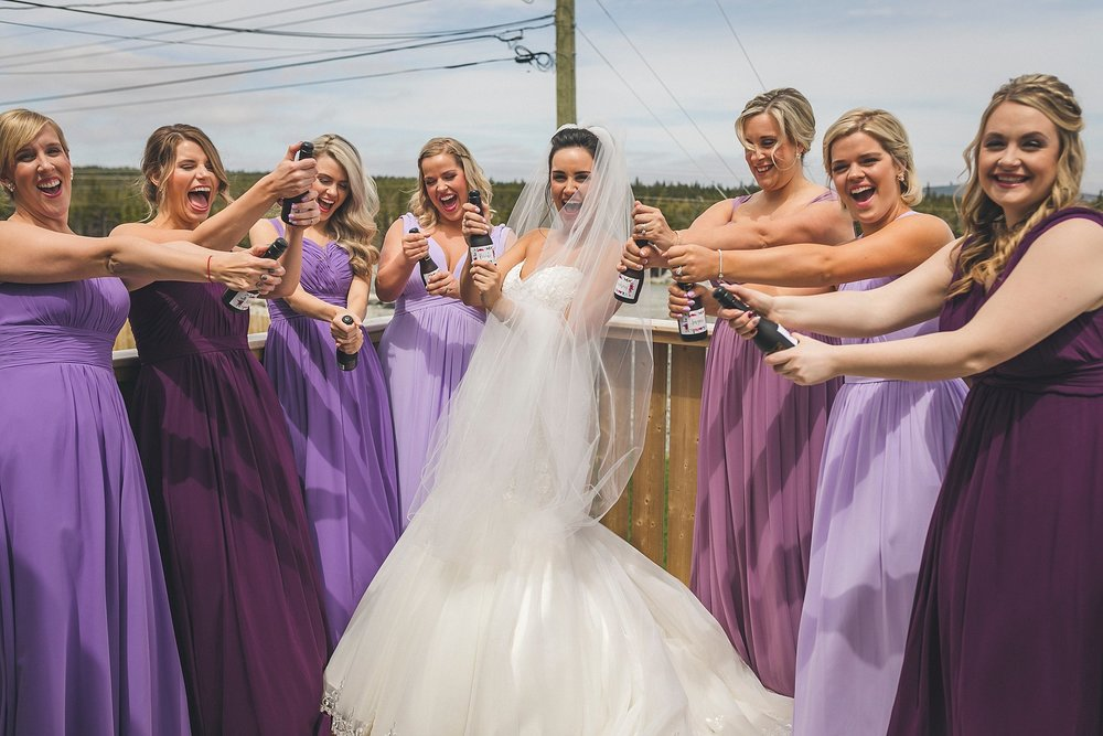 Bride and her Bridesmaids share a moment before her St. John's, Newfoundland wedding