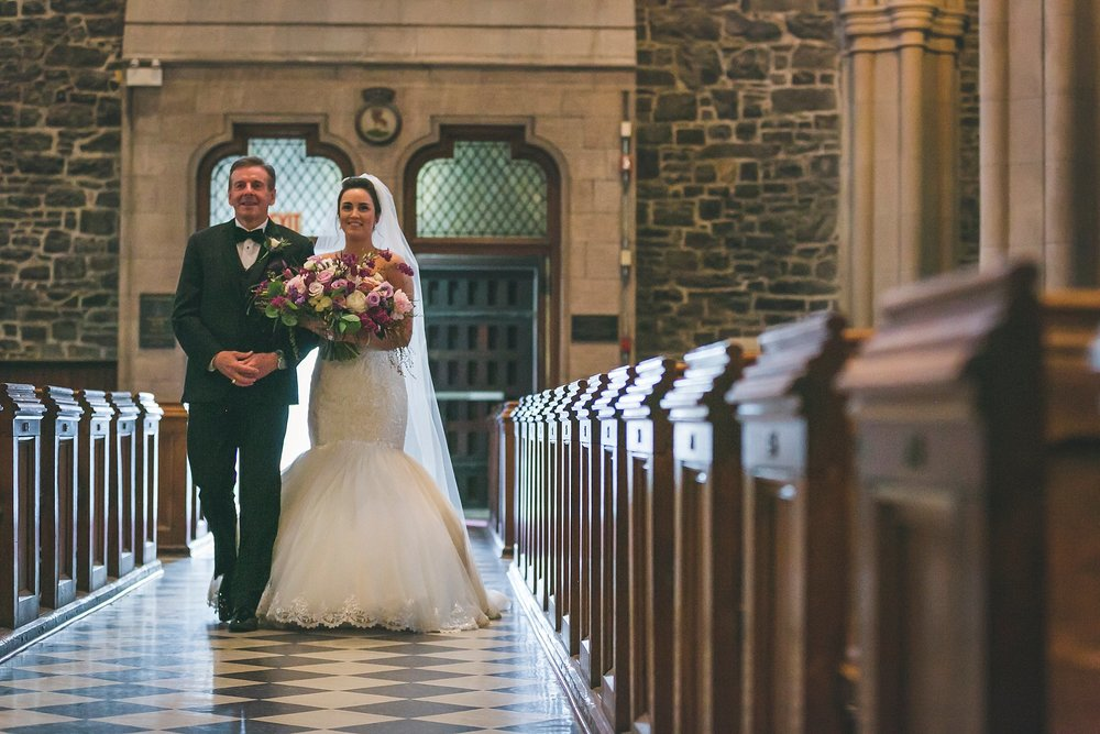 Father of the Bride walks her down the aisle in the Anglican Cathedral during a St. John's, Newfoundland wedding.
