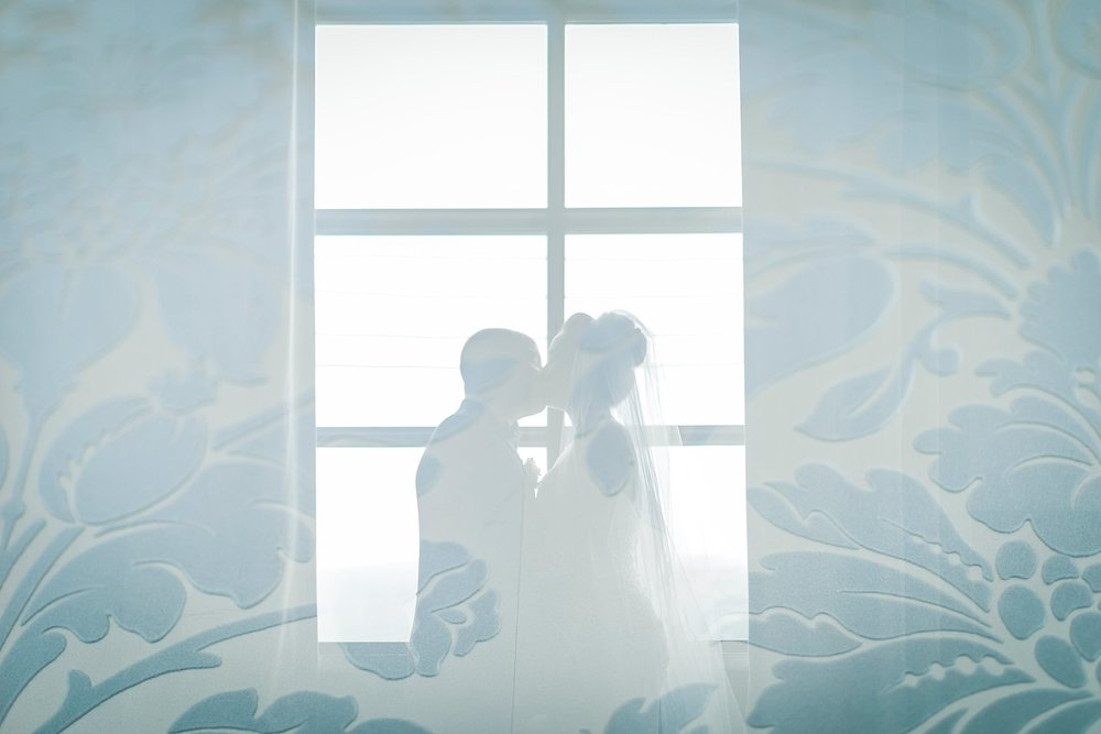 Double exposure of Bride and Groom inside Raymond's Restaurant in Downtown St. John's, Newfoundland