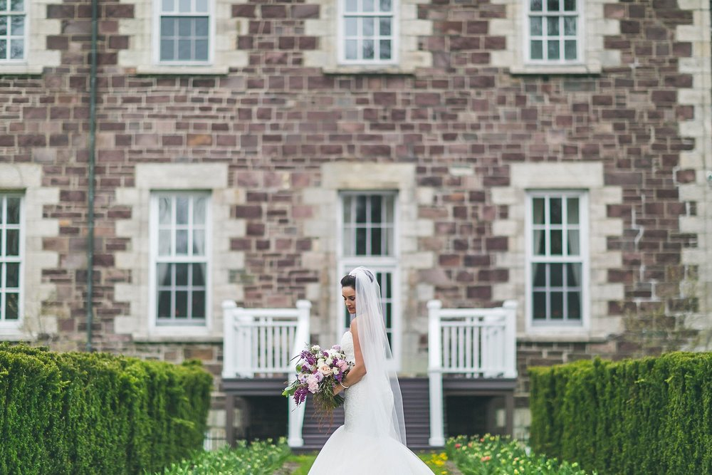 Bride in Maggie Sottero wedding dress outside Government House during a St. John's, Newfoundland wedding