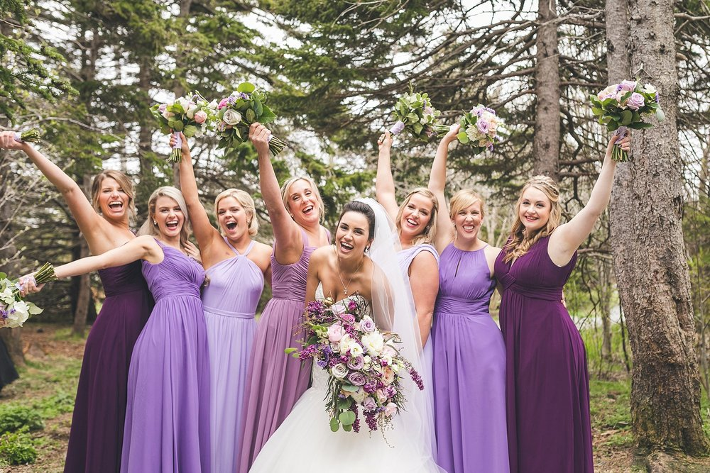 Bride and her Bridesmaids laugh in Pippy Park during a St. John's, Newfoundland wedding