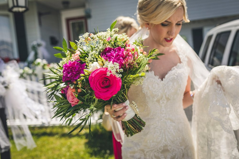 Bride leaving her house in her Casablanca wedding dress with flowers by Event3Sixty