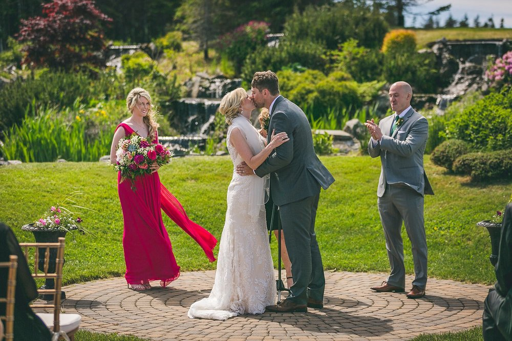 Bride and Groom share first kiss as Husband and Wife during outside ceremony at Glendenning in St. John's, Newfoundland