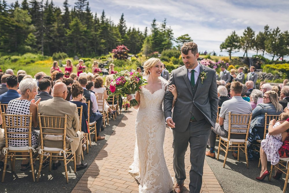 Husband and Wife walk down the aisle during outside wedding at Glendenning in St. John's, Newfoundland