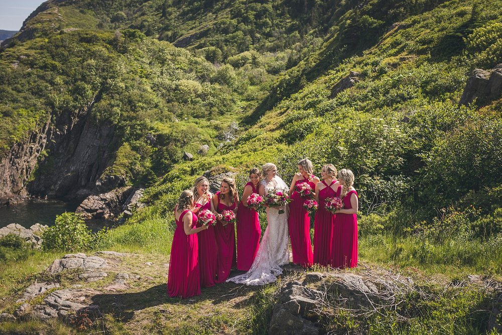 Bride and bridesmaids share a laugh in Cuckhold's Cove, St. John's, Newfoundland