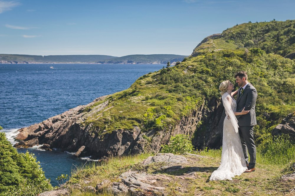 Bride in her Casablanca wedding dress hugs her husband during their wedding in St. John's, Newfoundland