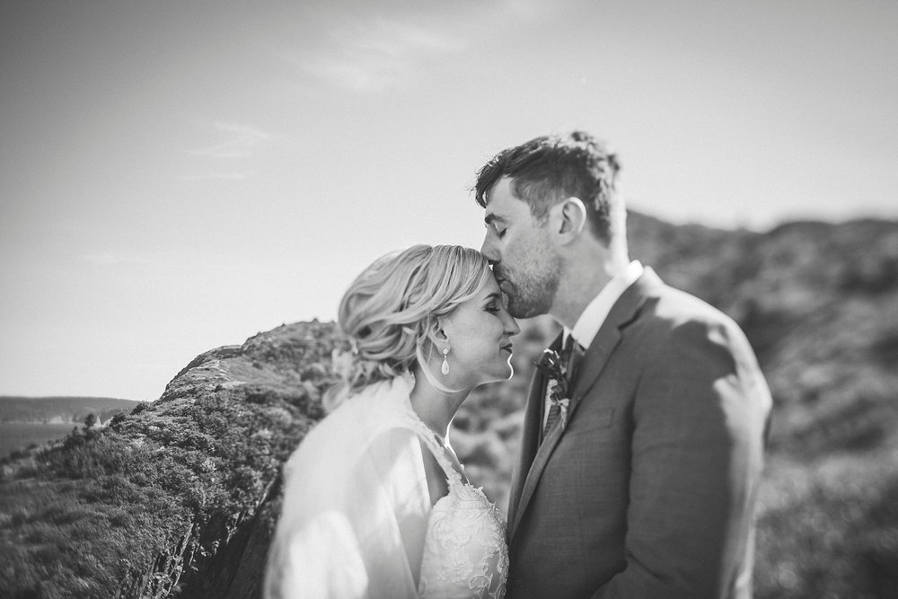 Bride and Groom share a kiss at Cuckhold's Cove during their wedding in St. John's, Newfoundland