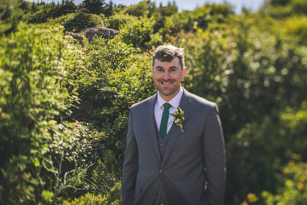 Groom in his custom Joseph Abboud suit during his St. John's, Newfoundland Wedding