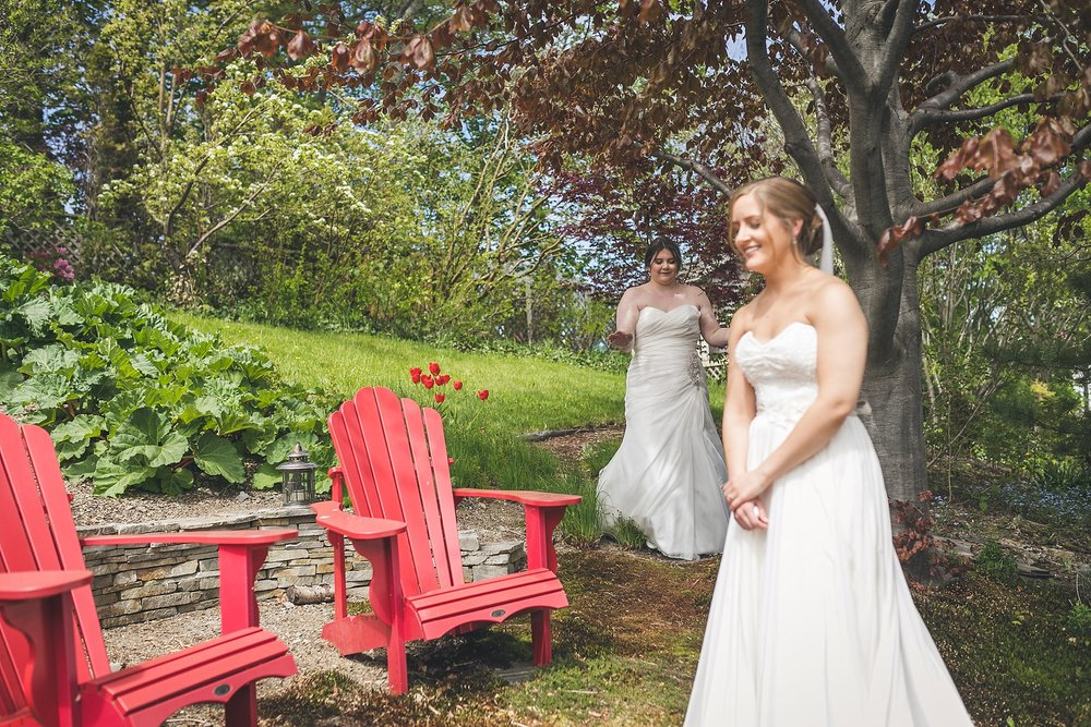 A couple is about to see each other during their first look at their Newfoundland wedding in St. John's